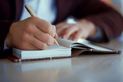 Hands write in a notebook royalty free stock image