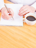 Hands writing with coffee, planning Royalty Free Stock Photography