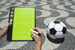 Hands Writing on Football Tactics Board Rio Beach Brazil Stock Image