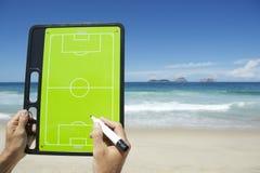 Hands Writing on Football Tactics Board Rio Beach Brazil. Hands writing on football tactics board on empty beach at Ipanema Rio de Janeiro Brazil Stock Photos