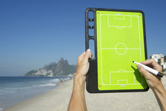 Hands Writing on Football Tactics Board Rio Beach Brazil Royalty Free Stock Image