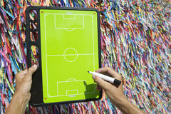 Hands Writing on Football Tactics Board Wish Ribbons Brazil Royalty Free Stock Image