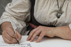 Hands writing a letter with a plume Royalty Free Stock Photography
