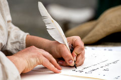 Hands writing a letter with a plume Royalty Free Stock Photo