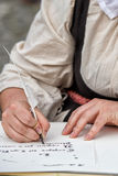 Hands writing a letter with a plume Stock Photo