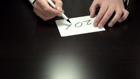 Hands writing the note 20 percent stock video footage