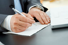 Hands writing notes Royalty Free Stock Photos