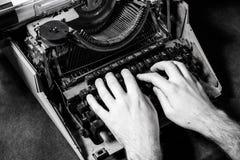Hands writing on old typewriter Royalty Free Stock Photos