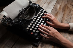 Hands writing on old typewriter Stock Photography