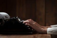 Hands writing on old typewriter Royalty Free Stock Image