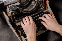 Hands writing on old typewriter Stock Photos