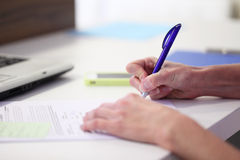 Hands writing with pen Royalty Free Stock Photos