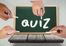 Hands writing quiz on blackboard. Digital composite of Hands writing quiz on blackboard royalty free stock images