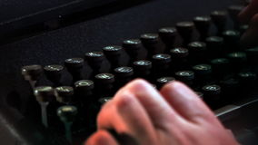 Hands writing on typewriter. Close up of hands writing on typewriter stock video