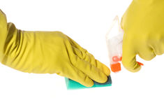 Hands in yellow gloves with sponge and bottle Stock Photo