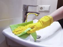 Hands in yellow gloves wash the sink interior hygiene household housekeeping. Hands in yellow gloves wash the sink protective housekeeping household hygiene Royalty Free Stock Photography