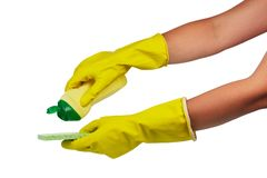 Hands in yellow household gloves with dishwashing detergent and sponge stock photos
