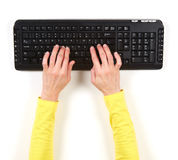 Hands in yellow jacket and black keyboard Royalty Free Stock Photo