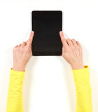 Hands in yellow jacket and black tablet Royalty Free Stock Photos