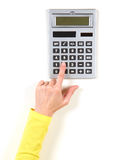 Hands in yellow jacket and grey calculator Royalty Free Stock Photography
