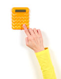 Hands in yellow jacket and yellow calculator Royalty Free Stock Images