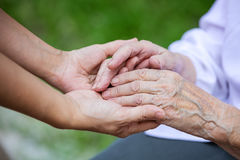 Hands of young adult and senior women Royalty Free Stock Images