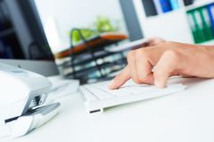 Hands of a young businessman typing on a keyboard while working on a desktop computer at the office space. Hands of a young businessman typing on a keyboard royalty free stock image