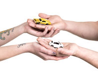 Hands of young couple with miniature cars Stock Photography