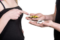 Hands of young couple with miniature cars Royalty Free Stock Photo
