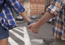 Hands of young couple on the street in Europe. Stock Photo