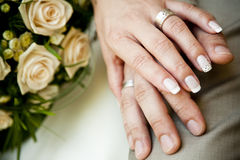 Hands of a young couple with wedding rings. Royalty Free Stock Photos