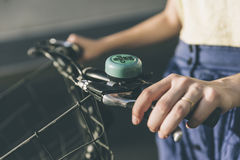 Hands of a young girl on old vintage bicycle handlebar Stock Image