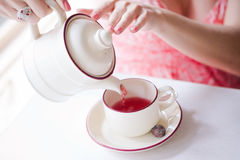 Hands of a young girl poured tea Royalty Free Stock Photography