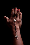 Hands of a young latin men with a crucifix Stock Images