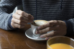 Hands of the young man drinking coffee Stock Photo