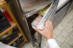 Hands of young man at home opening fridge Stock Images