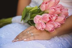 The hands of married couples and the wedding bouquet Stock Images