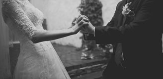 Hands of a young newly wed couple Royalty Free Stock Photography