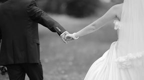 Hands of a young newly wed couple. Hands of a young newly wed heterosexual couple Stock Images