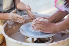 Hands of young potter, creating an earthen jar on the circle, cl Royalty Free Stock Images