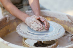 Hands of young potter, creating an earthen jar on the circle, cl Royalty Free Stock Photography