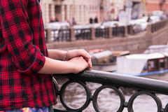 Hands of a young teenage girl standing on the bridge  the Moika River in St. Petersburg, Russia Royalty Free Stock Photo