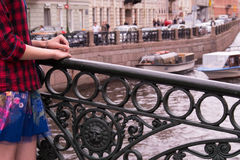 Hands of a young teenage girl standing on the bridge  the Moika River in St. Petersburg, Russia Stock Photos
