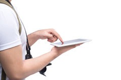 Hands of young traveler using tablet pc Royalty Free Stock Image