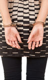 Hands of a young woman in handcuffs Stock Images