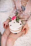 Hands of young woman holding birthday cake selective focus Stock Images
