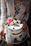 Hands of young woman holding birthday cake selective focus Stock Photography