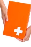 Hands of young woman holding first aid kit Royalty Free Stock Image