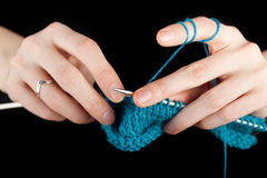 Hands of a young woman knitting Stock Photo