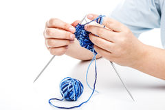 Woman knitting Stock Images